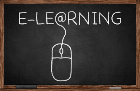 E-learning written on chalkboard with computer mouse